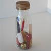 Flesje met verschillende materialen